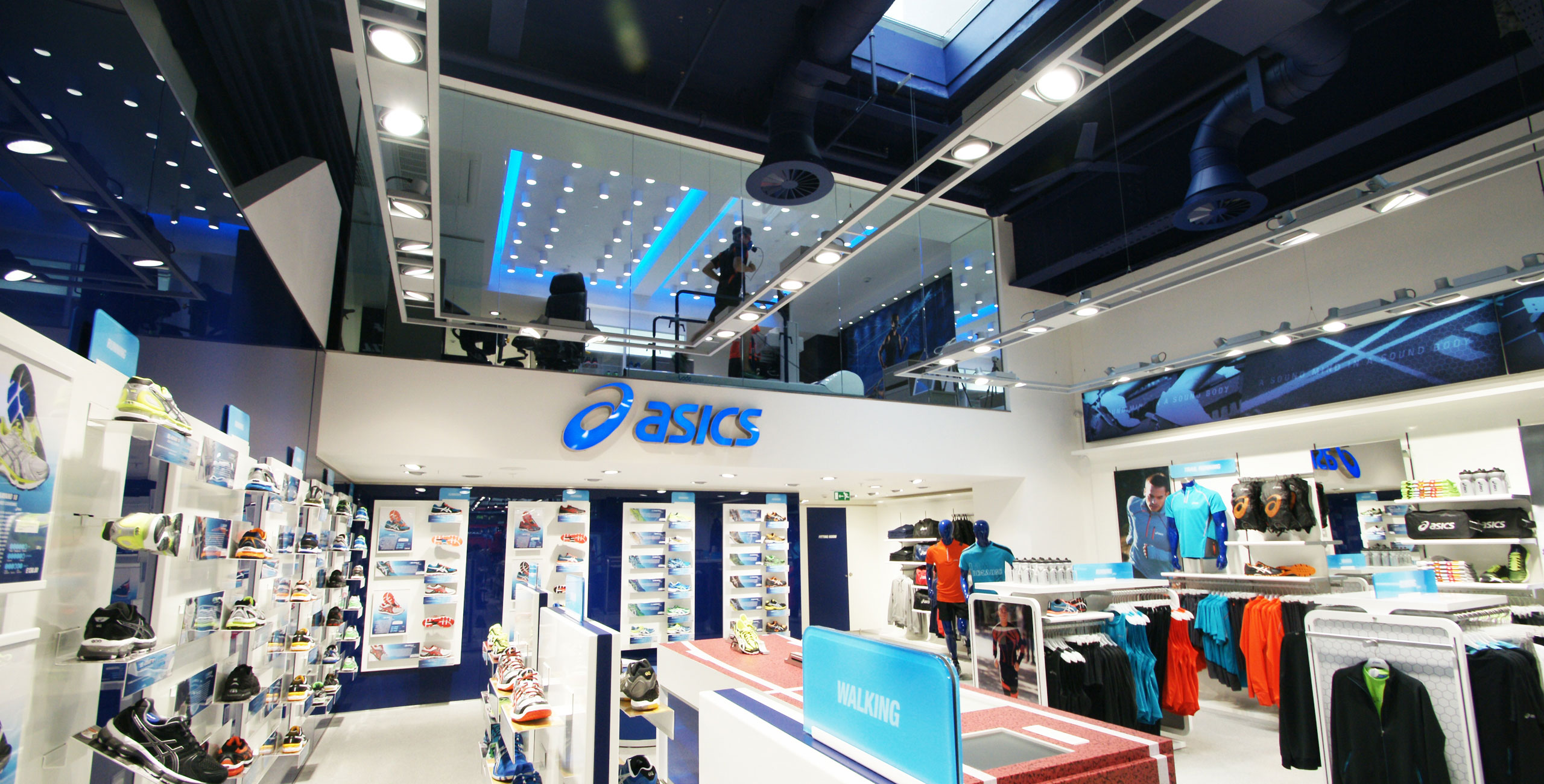 into lighting consultants design scheme for flagship asics store london