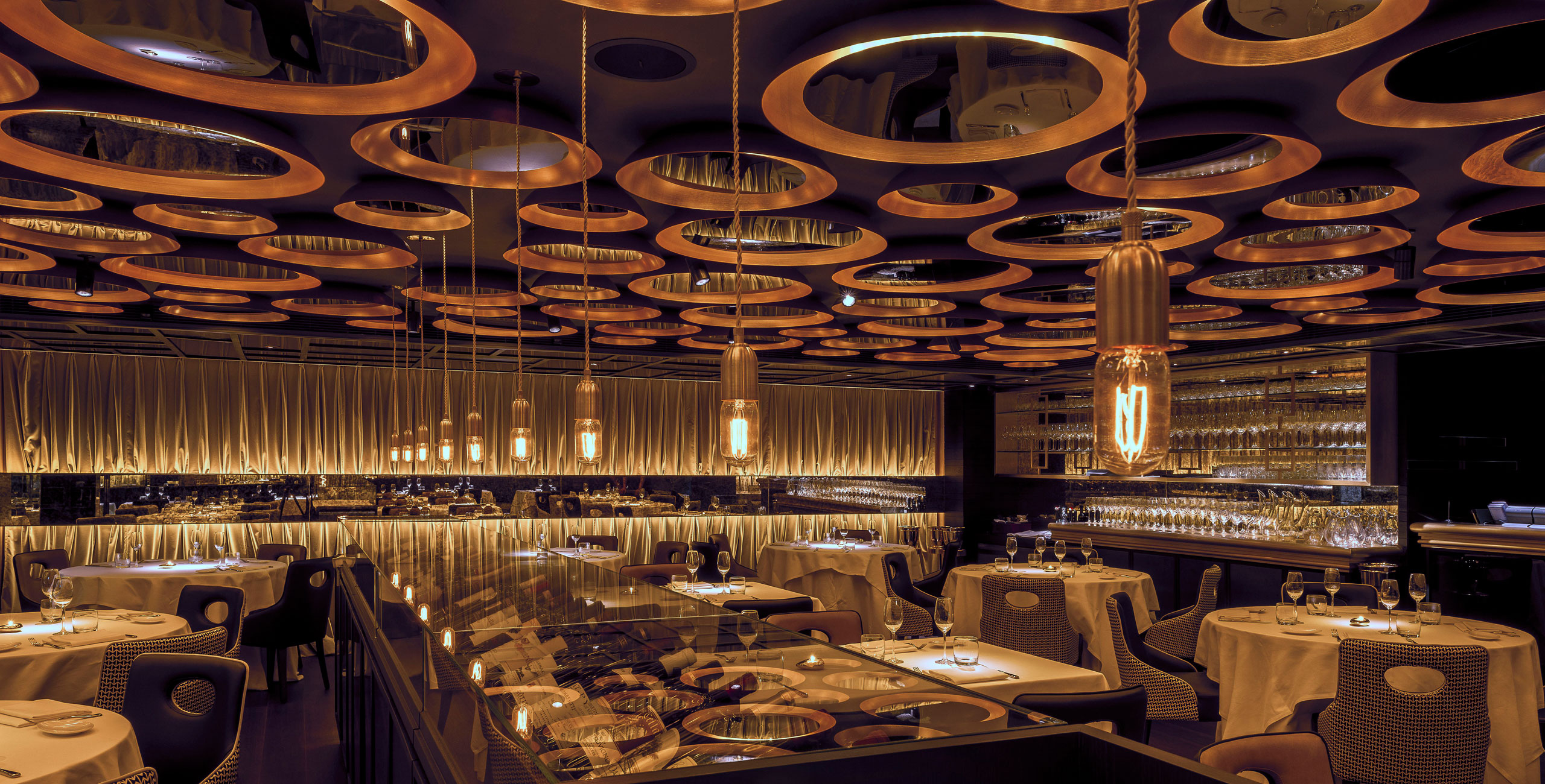 into lighting consultants design scheme for michelin starred il milione restaurant hong kong