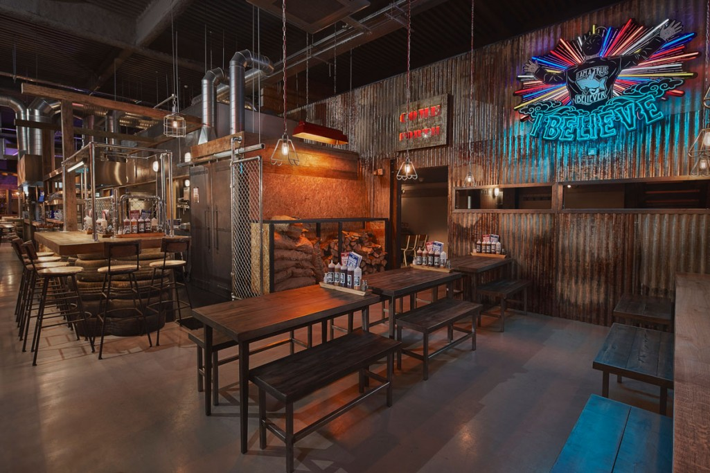 feature lighting and general scheme designed by into lighting for red's true bbq